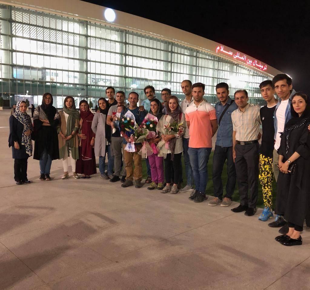 بازگشت فاطمه حاجی کریم لو و حسن گرامی از قزاقستان